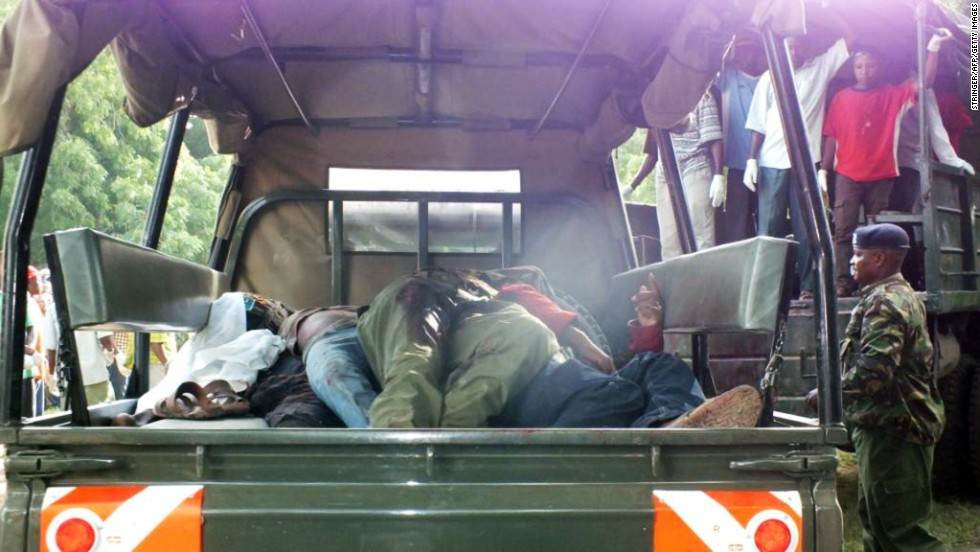 Bodies lie in the back of a truck during recovery efforts on June 16.