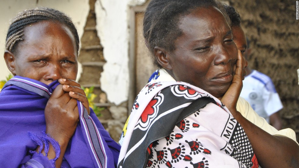 Women react after discovering the body of their relative at a hospital in Mpeketoni.