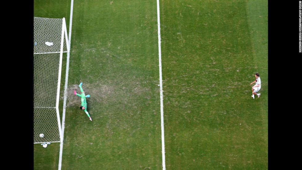 Mueller opens the scoring on a penalty kick, slotting the ball past Rui Patricio of Portugal. The penalty was awarded after Mario Goetze was brought down in the box.