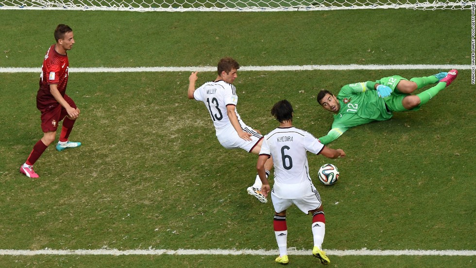 Germany's Thomas Mueller scores his third goal of the game -- and the fourth for his team -- en route to a 4-0 pasting of Portugal on June 16.