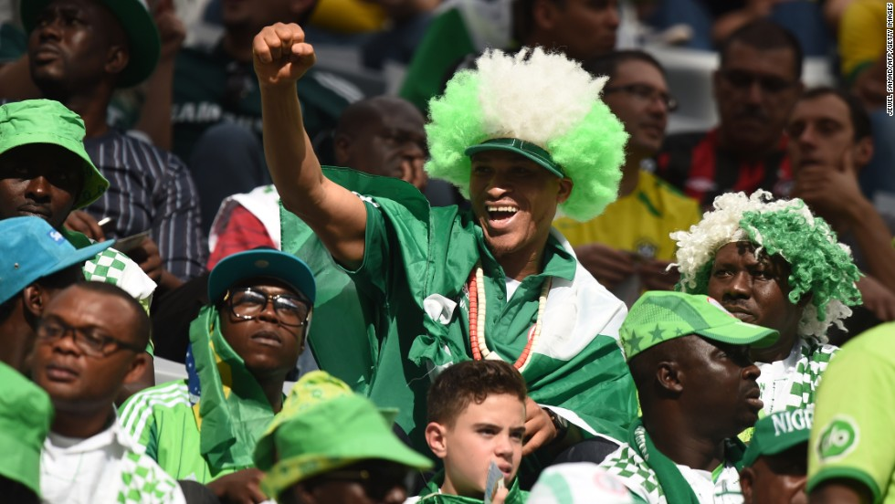 Nigeria fans cheer for their team before the start of the match.