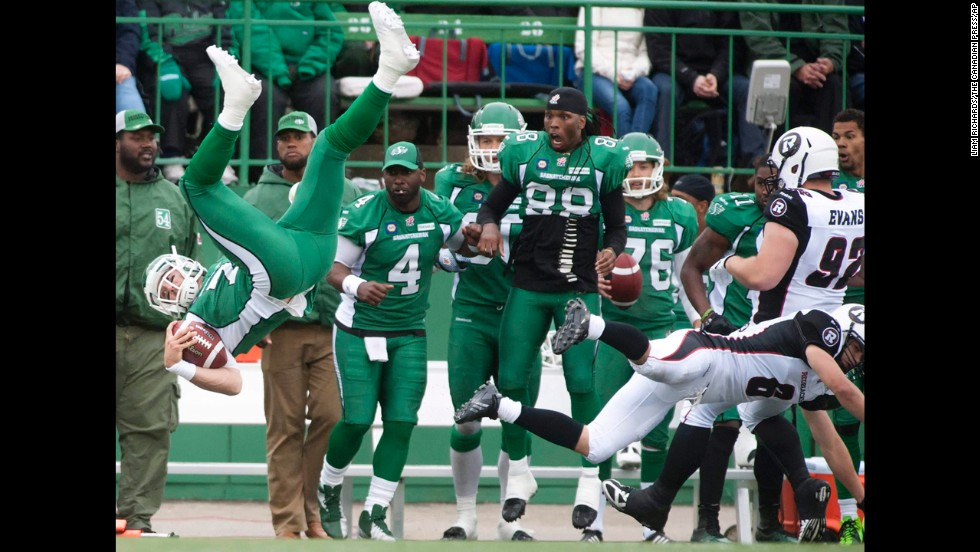 Seth Doege, quarterback of the Saskatchewan Roughriders, flips through the air after being hit in a Canadian Football League preseason game against the Ottawa Redblacks on Saturday, June 14. The Roughriders are the CFL's defending champions.