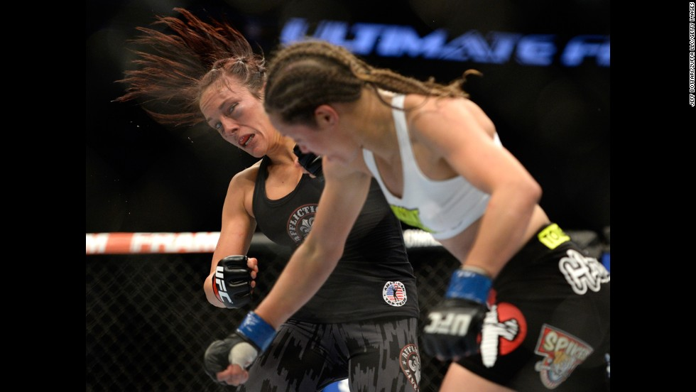 Elizabeth Phillips, right, punches Valerie Latourneau during UFC 174 on Saturday, June 14. Latourneau won the fight by split decision.
