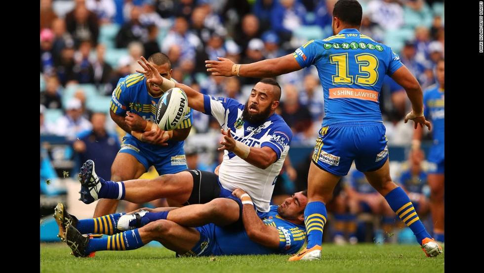 Sam Kasiano of the Canterbury-Bankstown Bulldogs offloads the ball during a National Rugby League match against the Parramatta Eels on Sunday, June 15, in Sydney. The Eels won the match 22-12.