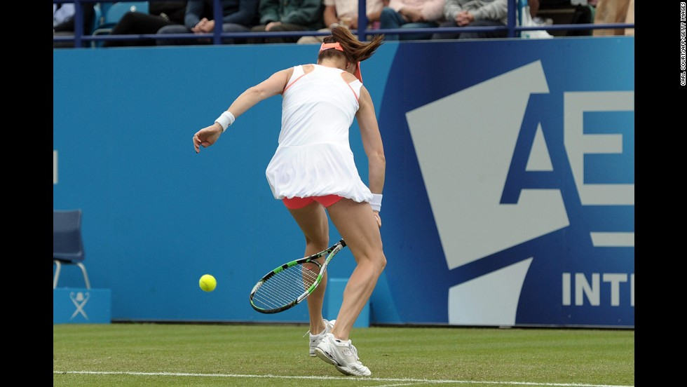 Agnieszka Radwanska returns a shot during her first-round match against Anastasia Pavlyuchenkova at the Aegon Championships in London on Monday, June 16. Radwanska was the top seed at the tournament, but she lost to Pavlyuchenkova in three sets.