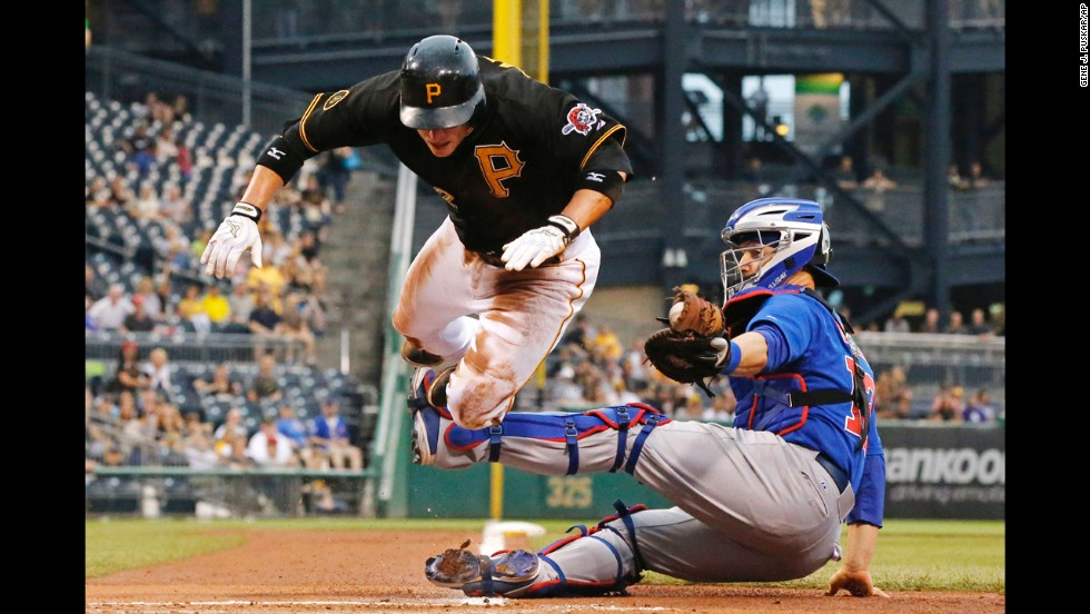 Chicago Cubs catcher John Baker tags out Clint Barmes of the Pittsburgh Pirates on Thursday, June 12.