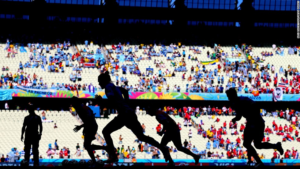 "Uruguayan soccer players warm up prior to their World Cup match against Costa Rica on Saturday, June 14. Costa Rica would later win the game 3-1 in Fortaleza, Brazil. <a href=""http://www.cnn.com/2014/06/10/worldsport/gallery/what-a-shot-0610/index.html"">See 42 amazing sports photos from last week</a>"