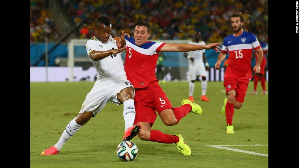 Besler, right, tries to win the ball from Jordan Ayew of Ghana.