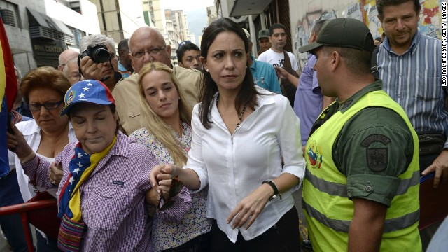 Venezuelan opposition leader Maria Corina Machado (C) arrives at the Prosecutor's office in Caracas on June 16, 2014 to declare about her presumed involvement in an alleged plot to assassinate President Nicolas Maduro.