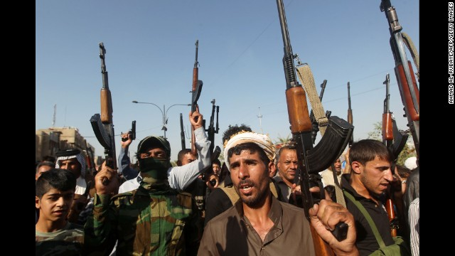 Iraqi tribesmen gather in Baghdad on Monday, June 16, to show their readiness to join Iraqi security forces in the fight against Jihadist militants who have taken over several northern Iraqi cities.