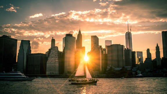 The sun drifts below the New York City skyline on a late June evening. Jeremy Aerts found the perfect spot to drink in the view of the East River at Brooklyn Bridge Park.