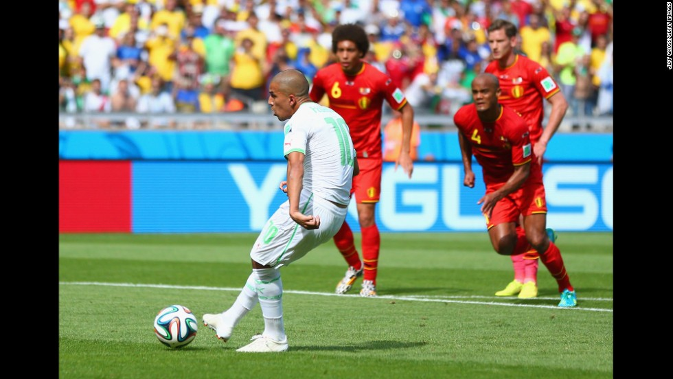 Sofiane Feghouli scores on a penalty kick to give Algeria a 1-0 lead.