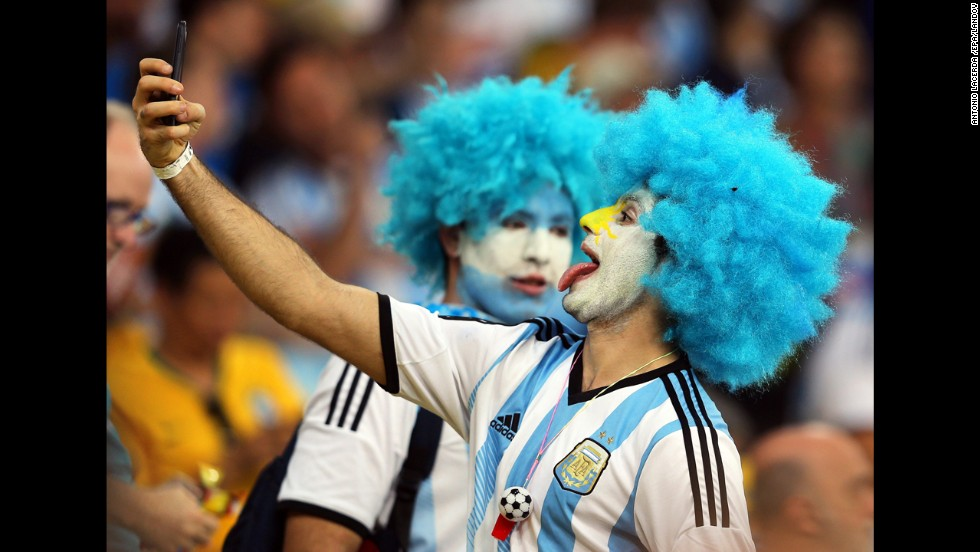 "An Argentina supporter takes a selfie before the World Cup match between Argentina and Bosnia-Herzegovina on Sunday, June 15, in Rio de Janeiro. <a href=""http://www.cnn.com/2014/06/11/world/gallery/look-at-me-0611/index.html"">See 31 selfies from last week</a>"