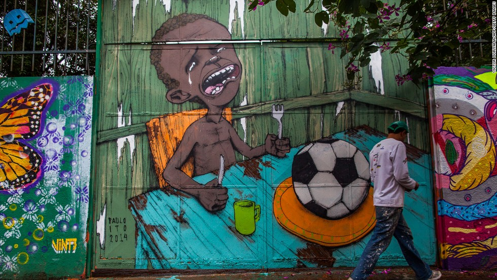 "Ito, meanwhile, achieved international fame with this image of a starving child being presented with a football after it was carried by several major news organizations.<br /><br />""I was trying to talk about football at the moment of the FIFA Cup,""said Ito.<br /><br />""I never say (the World Cup) is a bad thing at all but there are problems, like relocating people to live in other neighborhoods and particularly I don't agree with the way FIFA operates."""
