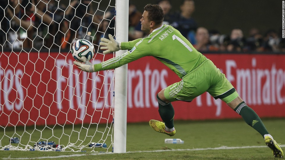 Russian goalkeeper Igor Akinfeev fails to stop South Korea from scoring the first goal of the game late in the second half.