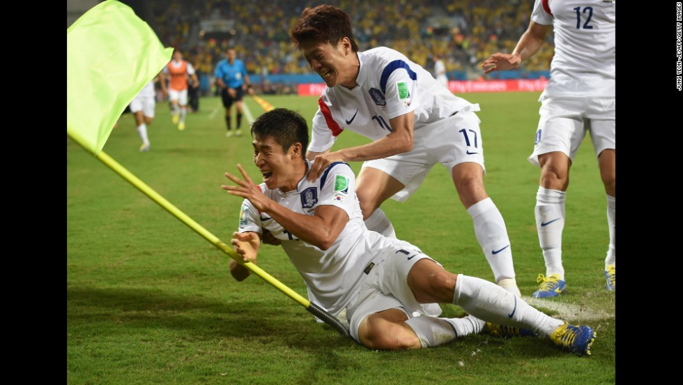 South Korean forward Lee Keun-Ho, left, celebrates with midfielder and captain Lee Chung-Yong after scoring the first goal of the game late in the second half.