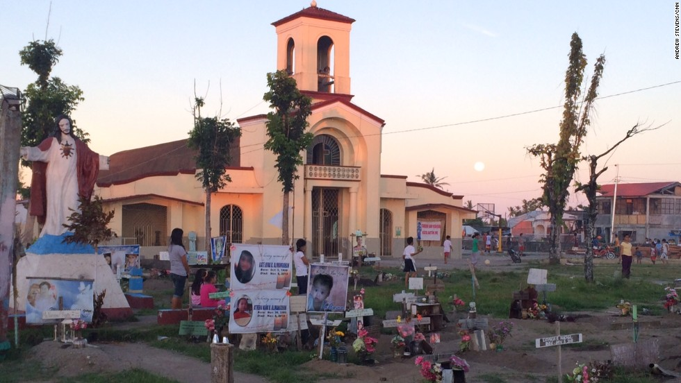 San Joaquin church in Palo,  just outside Tacloban with recent graves from those who died during Typhoon Haiyan.