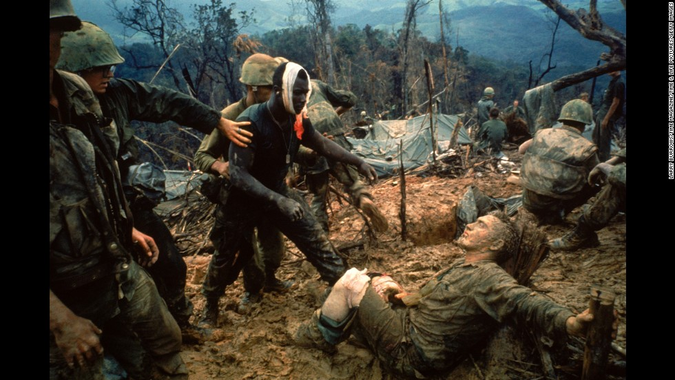"1960s photojournalists showed the world some of the most dramatic moments of the Vietnam War through their camera lenses. LIFE magazine's Larry Burrows photographed wounded Marine Gunnery Sgt. Jeremiah Purdie, center, reaching toward a stricken soldier after a firefight south of the Demilitarized Zone in Vietnam in 1966. Commonly known as <a href=""http://life.time.com/history/vietnam-war-the-story-behind-larry-burrows-1966-photo-reaching-out/#1"" target=""_blank"">Reaching Out,</a><em> </em>Burrows shows us tenderness and terror all in one frame. According to LIFE, the magazine did not publish the picture until five years later to commemorate Burrows, who was killed with AP photographer Henri Huet and three other photographers in Laos."