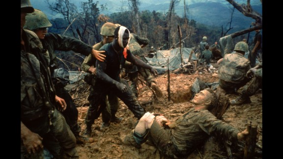 1960s photojournalists showed the world some of the most dramatic moments of the Vietnam War through their camera lenses. LIFE magazine's Larry Burrows photographed wounded Marine Gunnery Sgt. Jeremiah Purdie, center, reaching toward a stricken soldier after a firefight south of the Demilitarized Zone in Vietnam in 1966. Commonly known as Reaching Out, Burrows shows us tenderness and terror all in one frame. According to LIFE, the magazine did not publish the picture until five years later to commemorate Burrows, who was killed with AP photographer Henri Huet and three other photographers in Laos.