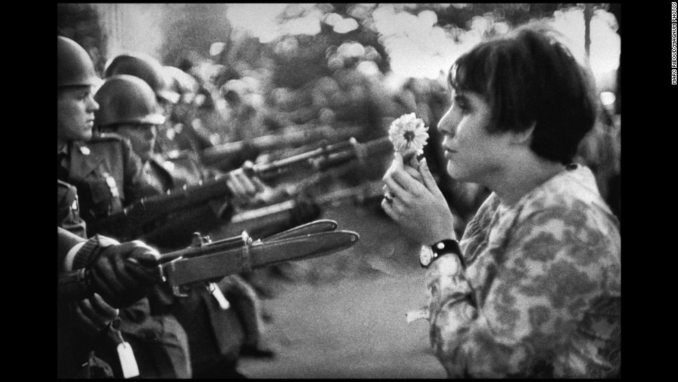"Frenchman Marc Riboud captured one of the most well-known anti-war images in 1967. Jan Rose Kasmir confronts National Guard troops outside the Pentagon during a protest march. The photo helped turn public opinion against the war. ""She was just talking, trying to catch the eye of the soldiers, maybe try to have a dialogue with them,"" <a href=""http://www.smithsonianmag.com/history/flower-child-102514360/"" target=""_blank"">recalled Riboud in the April 2004 Smithsonian magazine,</a> ""I had the feeling the soldiers were more afraid of her than she was of the bayonets."""