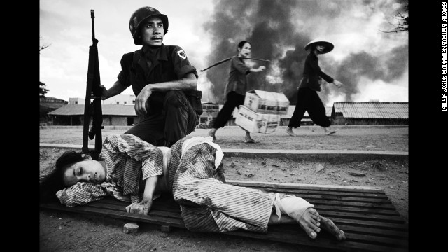 "Philip Jones Griffiths VIETNAM. The battle for Saigon. U.S. policy in Vietnam was based on the premise that peasants driven into the towns and cities by the carpet-bombing of the countryside would be safe. Furthermore, removed from their traditional value system they could be prepared for imposition of consumerism. This ""restructuring"" of society suffered a setback when, in 1968, death rained down on the urban enclaves. 1968 Image ReferenceGRP1968010N00001/06(PAR93989)© Philip Jones Griffiths/Magnum Photo"