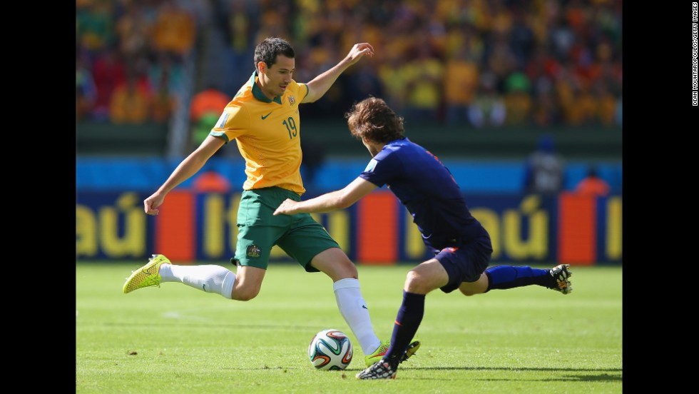 Ryan McGowan of Australia, left, takes on Daley Blind of the Netherlands.