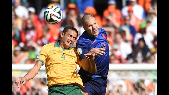Cahill and Vlaar compete for a header.