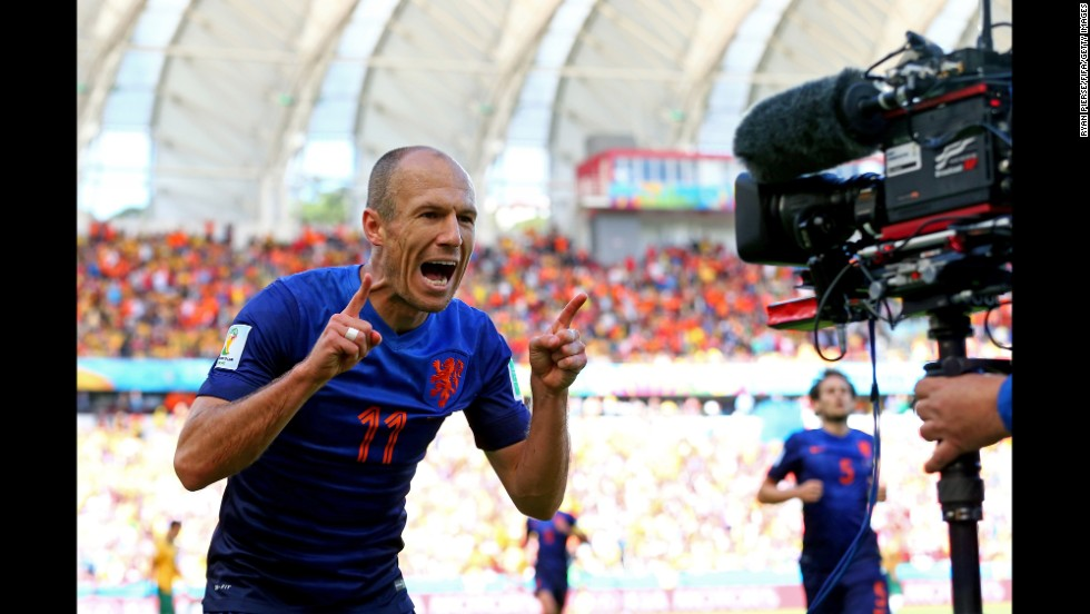 Arjen Robben celebrates after scoring a goal to put the Netherlands up 1-0 in the first half. It was Robben's third goal of the tournament.