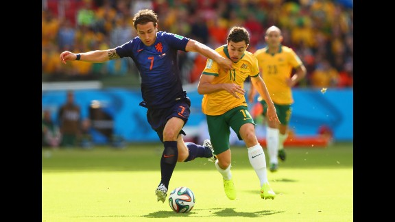 Daryl Janmaat of the Netherlands, left, fights off Tommy Oar of Australia.