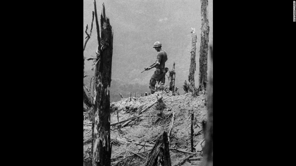 For his dramatic photographs of the Vietnam War, United Press International staff photographer David Hume Kennerly won the 1972 Pulitzer Prize for feature photography. This 1971 photo from Kennerly's award-winning portfolio shows an American GI, his weapon drawn, cautiously moving over a devastated hill near Firebase Gladiator.