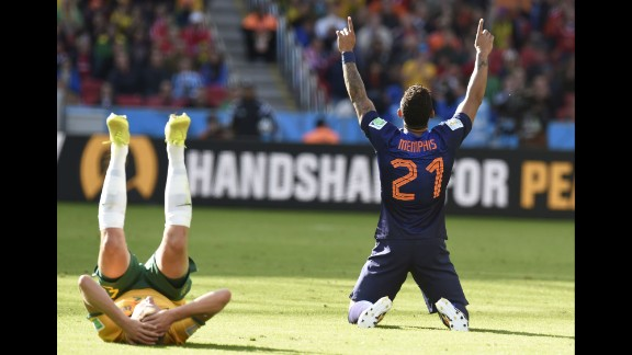 Netherlands forward Memphis Depay celebrates at the end of his team
