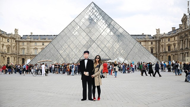 Timeless travelers: Jinna Yang with cutout of her father at the Louvre in Paris.