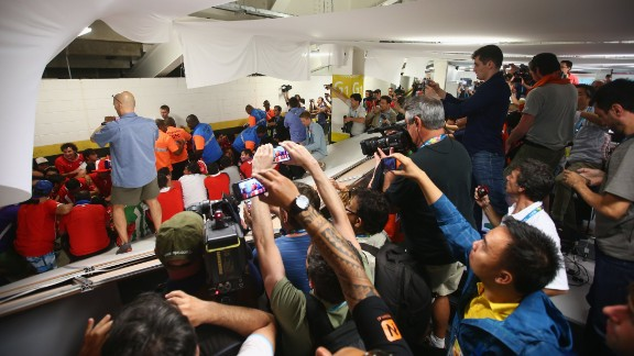 Security personnel attempt to control Chilean fans who invaded the press room at the Maracana Stadium before the match.