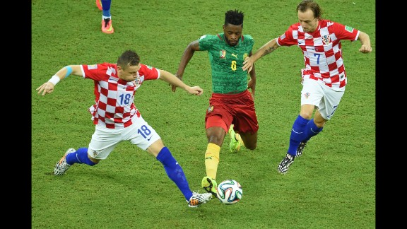 Ivica Olic of Croatia, left, and teammate Ivan Rakitic vie for the ball against Cameroon