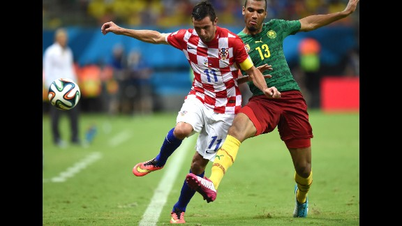 Cameroon's Eric Maxim Choupo-Moting, right tackles Croatia's Darijo Srna during a World Cup match in Manaus, Brazil, on Wednesday, June 18. Croatia won 4-0.