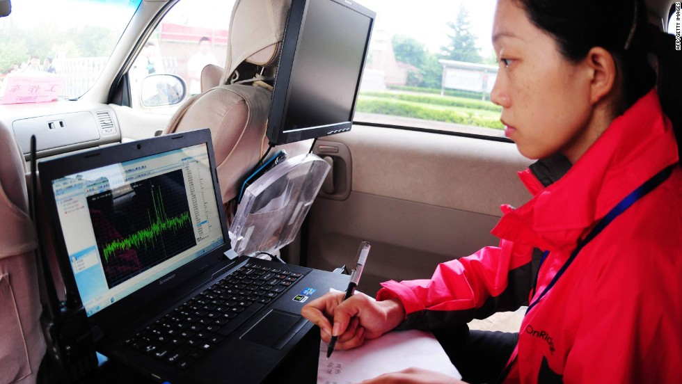 Radio signals are monitored and students are checked with scanners before and during the 2013 university entrance exams in China. The country has been pro-active in its attempts to crack down on high tech cheats.