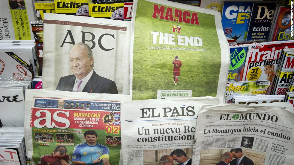 Newspapers in Valencia, Spain, cover the abdication as well as Spain's elimination from the World Cup.