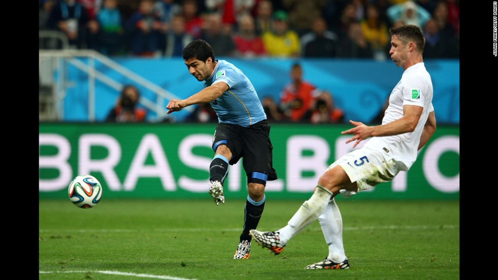 Uruguayan forward Luis Suarez drills a shot to score a late second-half goal and defeat England 2-1 in a World Cup match Thursday, June 19, in Sao Paulo, Brazil. Suarez had both of Uruguay's goals.