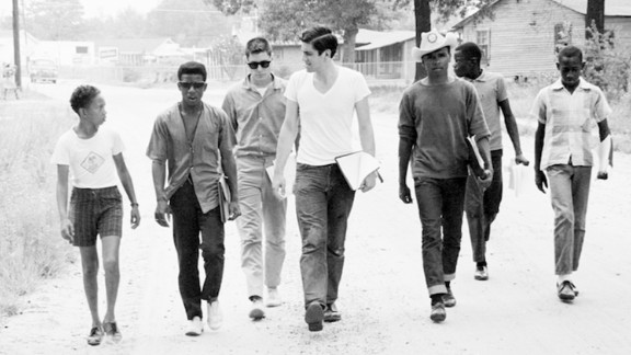 """A group of Freedom Summer volunteers and locals canvass in Mississippi. A PBS documentary, """"Freedom Summer,"""" looks back at an interracial group of college students who worked in Mississippi for 10 weeks in summer 1964 to register African-American voters."""