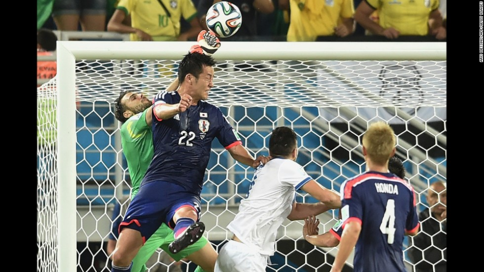 Greece's goalkeeper Orestis Karnezis, left, vies for the ball with Japan defender Maya Yoshida, second left  during a World Cup match on Thursday, June 19, in Natal, Brazil. The game ended in a draw.