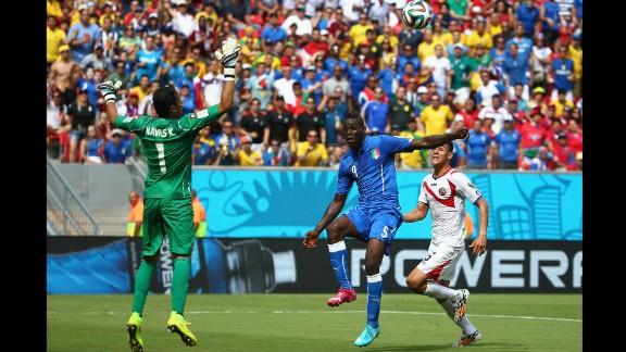 Balotelli, center, shoots wide past Costa Rican goalkeeper Keylor Navas.