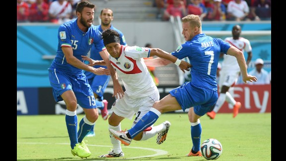 Bolanos, center, tries to make it past Abate, right, and Barzagli.