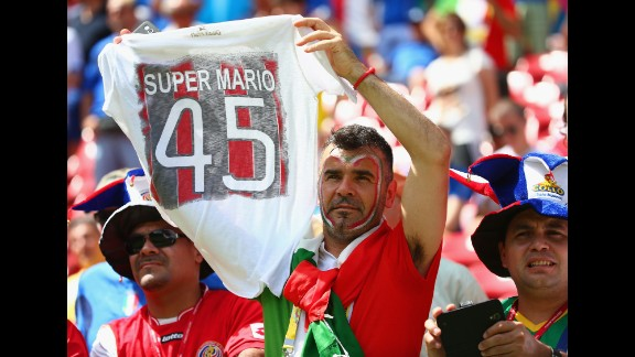 An Italy fan holds up a T-shirt honoring Balotelli before the match. See the best World Cup photos from June 19.