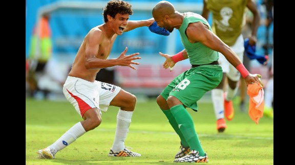 Yeltsin Tejeda of Costa Rica, left, celebrates with teammate Patrick Pemberton after they defeated Italy 1-0 during a World Cup match in Recife, Brazil. With the victory, Costa Rica clinched a spot in the next round of the tournament.