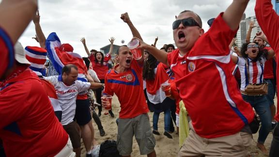 Costa Rica fans react while watching from a beach in Rio de Janeiro.