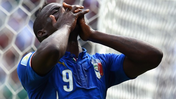 Italy forward Mario Balotelli reacts to a missed chance.