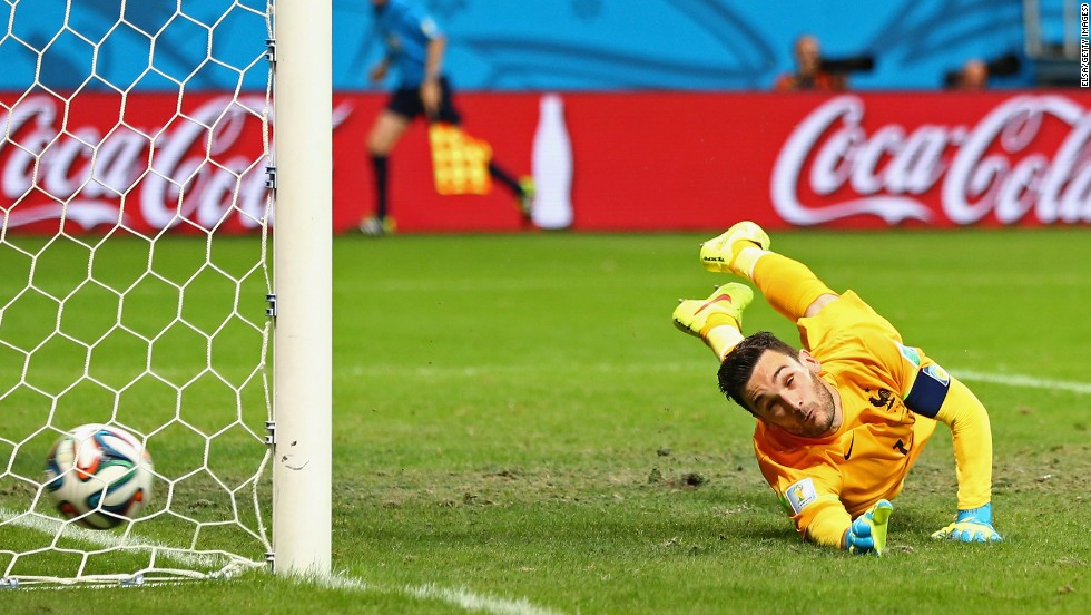 French goalkeeper Hugo Lloris can't get to a free kick from Switzerland's Blerim Dzemaili in the second half. France led 5-0 to that point.