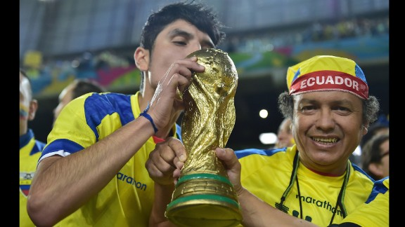 Ecuador supporters pose with a World Cup trophy replica before the game.