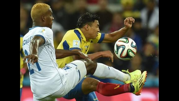 Honduras defender Brayan Beckeles, left, controls the ball during a World Cup match between Honduras and Ecuador at the Baixada Arena in Curitiba, Brazil, on Friday, June 20.  Ecuador defeated Honduras 2-1.