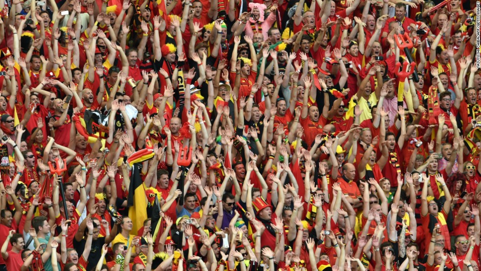 Belgian supporters cheer for their team.